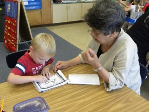 Volunteer Antonia Matias with student Jacob Meyer in Mrs. Hales' classroom