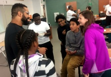 Ravens lineman John Urschel talks with Dundalk High Math Academy students following a lesson about how ice cream is made.