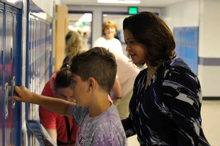 Photo of BCPS Interim Superintendent Verletta White assisting a student during Early Entry Day.