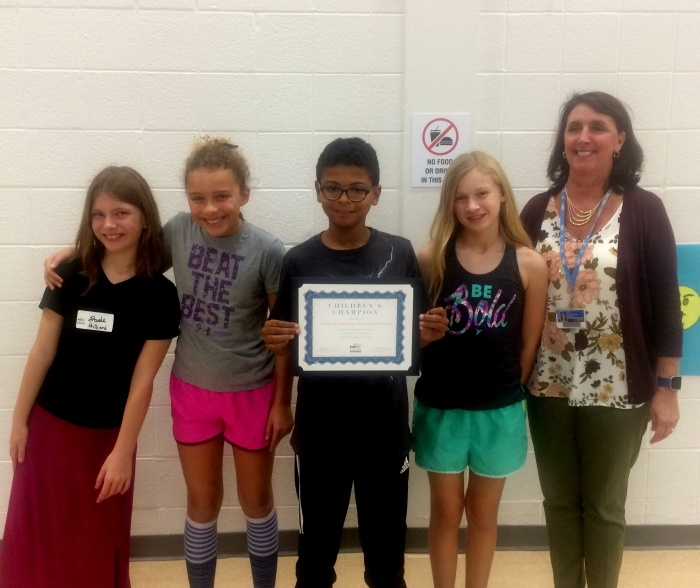 Photo of Catonsville Elementary students accepting Children's Champion award.