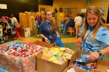 Photo of teachers gathering donated school supplies for their classrooms.