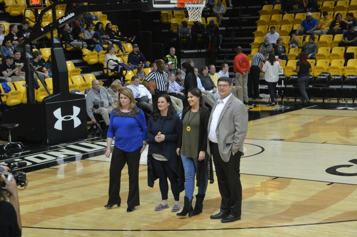 Perry Hall and Johnnycake Elementary staff were recognized on court at Towson University.