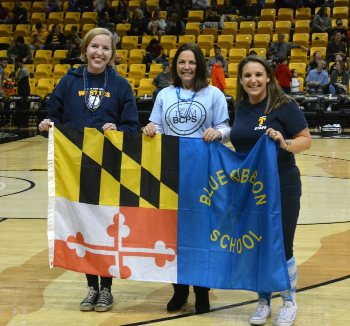 West Towson ES staff recognized on court at Towson University